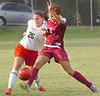 #3 for THS pushes her way in front of #25 of South as they fight for the ball. Photo by Ned Jilton II