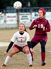 #9 for Dobyns Bennett has position on #19 of Morristown West while eyeing the ball for a header. Photo by Ned Jilton II
