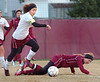 #7 for Dobyns Bennett advances the ball as #14 for Morristown East hits the ground. Photo by Ned Jilton II