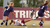 #27 for D-B struggles to retain control of the ball while on the ground. Photoby Ned Jilton II