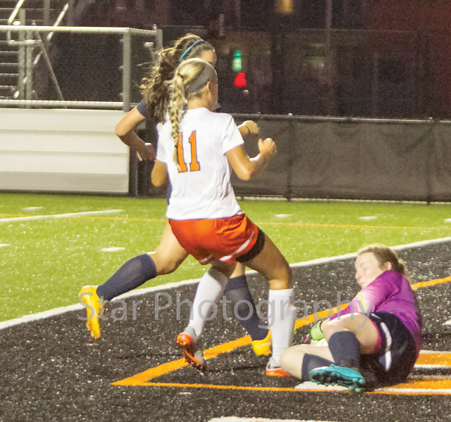 Star Photo/Larry N. Souders<br /> The goalie for University High's comes forward to stop a shot on goal by the Lady Cyclone (11) midway through the second half.