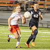 Star Photo/Larry N. Souders<br /> The Lady Cyclone's (10) and a University High defender compete for a ball at midfield early in the second half.