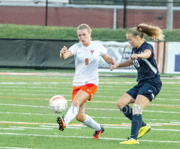 Star Photo/Larry N. Souders<br /> Elizabethton's (8) attacks a ball at midfield late in the first half.