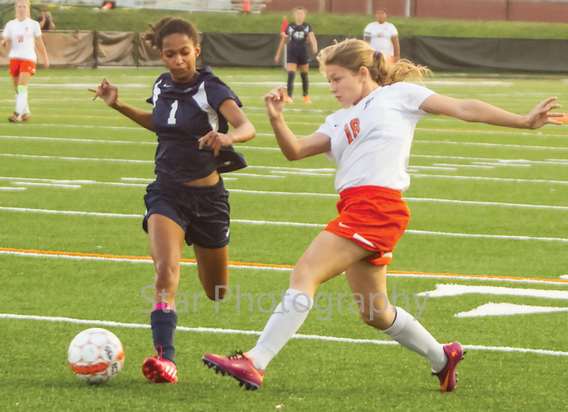 Star Photo/Larry N. Souders<br /> The Lady Cyclone's (18) looks to move the ball down field against a University High defender.