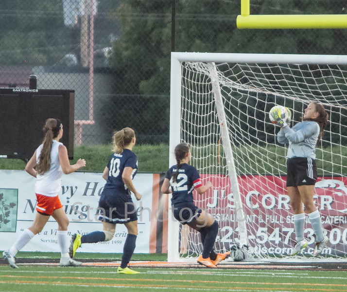 Star Photo/Larry N. Souders<br /> The Lady Cyclone's goalie make a leaping stop of a shot on goal late in the first half of Tuesday night's match with University High.