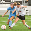 Star Photo/Larry N. Souders<br /> The Lady Cyclones's (10) dribbles the ball down field against a defender from Sullivan South.