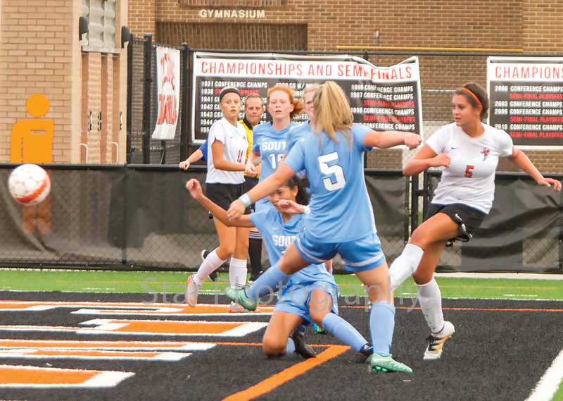 Star Photo/Larry N. Souders<br /> Elizabethton's (5) scores the  Lady Cyclones's first goal of the match splitting two Lady Rebels defenders at the 24 minute mark of the first half.