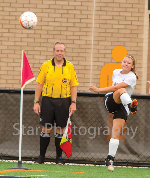 Star Photo/Larry N. Souders<br /> The Lady Cyclones's (20) delivers a corner kick in first half action against the Lady Rebels of Sullivan South.