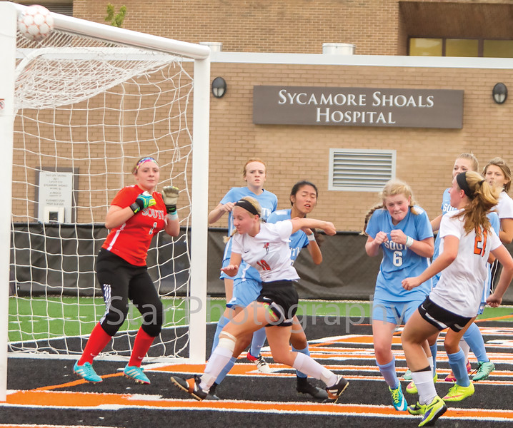 Star Photo/Larry N. Souders<br /> The Lady Cyclones's (21) takes a corner kick, but her shot on goal hits the crossbar and bounces out of bounds.
