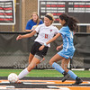 Star Photo/Larry N. Souders<br /> Lady Cyclones's (11) looks to center the ball against a Sullivan South's (10) in the first half of Thursday's match at Elizabethton.