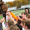 Record-Eagle/Brett A. Sommers Leland celebrates the first boys soccer state championship in program history following Saturday's soccer game at Comstock Park High School. Leland defeated Ann Arbor Greenhills 1-0.