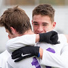 Record-Eagle/Brett A. Sommers Leland's Owen Kareck embraces teammate J.J. Popp following Saturday's Division 4 state championship soccer game at Comstock Park High School. Leland defeated Ann Arbor Greenhills 1-0.