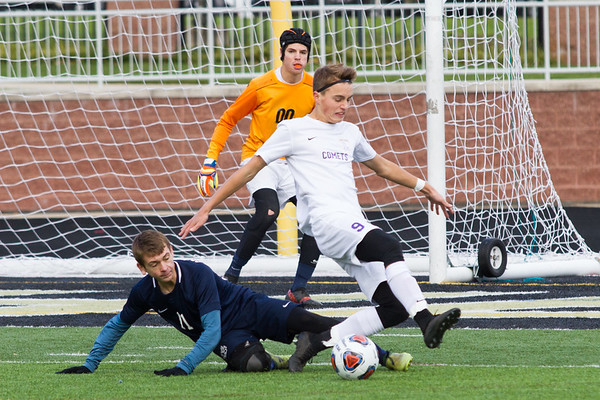 Record-Eagle/Brett A. Sommers Leland's Michael Roberts (9) and Ann Arbor Greenhills' Evan DeRose (11) battle for possession of the ball during Saturday's Division 4 state championship soccer game at Comstock Park High School. Leland won 1-0.
