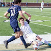 Record-Eagle/Brett A. Sommers Leland's J.J. Popp performs a slide tackle against Ann Arbor Greenhills' Zachary Zimmerman during Saturday's Division 4 state championship soccer game at Comstock Park High School. Leland won 1-0.