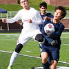 Record-Eagle/Brett A. Sommers Leland's Jack Munoz (19) battles Ann Arbor Greenhills' Lawrence Bitzer for possession of the ball during Saturday's Division 4 state championship soccer game at Comstock Park High School. Leland won 1-0.