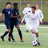 Record-Eagle/Brett A. Sommers Leland's Jesus Calderon-Balcazar (right) looks to pass the ball during Saturday's Division 4 state championship soccer game at Comstock Park High School. Leland defeated Ann Arbor Greenhills 1-0.