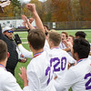 Record-Eagle/Brett A. Sommers Leland coach Joe Burda raises the Division 4 state championship trophy to his team following Saturday's soccer game at Comstock Park High School. Leland defeated Ann Arbor Greenhills 1-0.