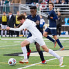 Record-Eagle/Brett A. Sommers Leland's Andre Masse dribbles by Ann Arbor Greenhills' Mikias Tamrat during Saturday's Division 4 state championship soccer game at Comstock Park High School. Leland won 1-0.