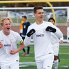 Record-Eagle/Brett A. Sommers Leland's Nick Saffell (left) and Owen Kareck celebrate teammate Jesus Calderon-Balcazar's goal during Saturday's Division 4 state championship soccer game at Comstock Park High School. Leland defeated Ann Arbor Greenhills 1-0.