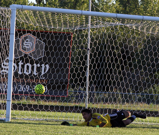 Record-Eagle/James Cook Leland goaltender Andy Mosqueda makes a penalty-kick save Wednesday against Buckley.