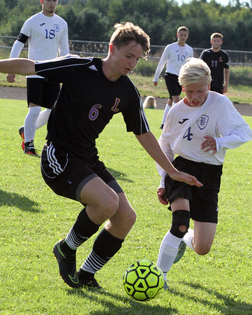 Record-Eagle/James Cook Leland's Christopher Ursu (6) advances the ball as Buckley's Kallen Wildfong defends Wednesday in Buckley. Leland won 1-0 in a shootout.