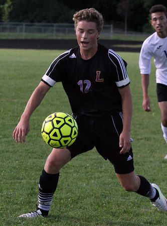 Record-Eagle/James Cook Leland's Hank Guest (12) tries to settle the ball in Wednesday's game at Buckley. The Comets won 1-0 in a shootout.