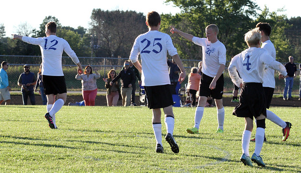 Record-Eagle/James Cook Buckley's Austin Harris (12) and Denver Cade (21) point toward a referee after teh first overtime ended Wednesday against Leland. The referee rules that Noah Fetterolf's goal came after time had expired.