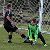 Record-Eagle/James Cook Buckley goalie Joe Weber (33) makes a save against Leland's Christopher Ursu (6) in Wednesday's game at Buckley.