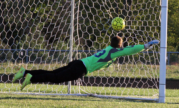 Record-Eagle/James Cook A penalty-kick goal by Leland's Noah Fetterolf goes into the net as Buckley goalie Joe Weber dives Wednesday in Buckley.