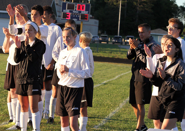 Record-Eagle/James Cook Buckley's bench cheers during the penalty-kick shootout Wednesday against Leland in Buckley.