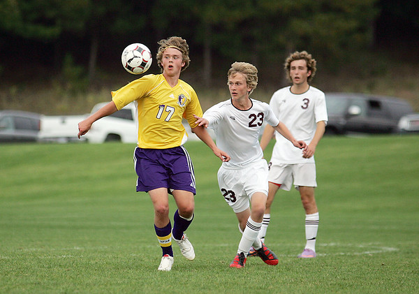Record-Eagle/Keith King<br /> Leland's Aaron Jolliffe, left, and Traverse City Christian's Jared Argyle go after the ball Thursday, September 23, 2010 at the Keystone Soccer Complex.
