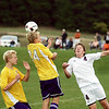Record-Eagle/Keith King<br /> Leland's Austin Fellows heads the ball near Traverse City Christian's Jon Tuck, right, Thursday, September 23, 2010 at the Keystone Soccer Complex.