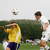 Record-Eagle/Keith King<br /> Traverse City Christian's Ian Spencer, right, heads the ball near Leland's Matt Fleis Thursday, September 23, 2010 at the Keystone Soccer Complex.