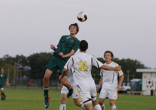 Record-Eagle/Keith King<br /> Traverse City West's Noah Cobb heads the ball against Traverse City Central Tuesday, September 11, 2012 at the Traverse City Central Soccer Complex at the Coast Guard Field.