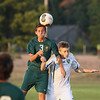 Record-Eagle/Keith King<br /> Traverse City West's Cameron Sipple heads the ball near Traverse City Central's Owen Stratton Tuesday, September 11, 2012 at the Traverse City Central Soccer Complex at the Coast Guard Field.