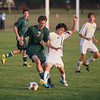 Record-Eagle/Keith King<br /> Traverse City West's Noah Cobb, left, and Traverse City Central's Mitchell Ward battle for possession of the ball Tuesday, September 11, 2012 at the Traverse City Central Soccer Complex at the Coast Guard Field.