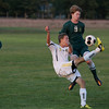 Record-Eagle/Keith King<br /> Traverse City Central's Matt Grost kicks the ball away from Traverse City West's Brad Richey Tuesday, September 11, 2012 at the Traverse City Central Soccer Complex at the Coast Guard Field.