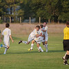 Record-Eagle/Keith King<br /> Traverse City Central's Matt Grost, at right in middle, is congratulated by teammates Adam Stepan, right, and Taylor Cook, left, as Mitchell Ward runs to join near Traverse City West's Brad Richey, far left, after Grost scores a goal against Traverse City West Tuesday, September 11, 2012 at the Traverse City Central Soccer Complex at the Coast Guard Field.