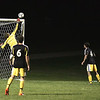 Record-Eagle/Keith King<br /> Traverse City Central goalkeeper Josh Lance deflects the ball away from the goal against Traverse City West Thursday, September 30, 2010 at Traverse City West Senior High School.