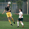 Record-Eagle/Keith King<br /> Traverse City Central's Keanen Armour heads the ball near Traverse City West's Austin Caccaglia Thursday, September 30, 2010 at Traverse City West Senior High School.