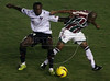 LDU's Joffre David Guerron, left, and Fluminense's Junior Cesar battle for possession of the ball during the Libertadores Cup final match in the Maracana Stadium of Rio de Janeiro, Brazil, July 2, 2008. Brazil's Fluminense beat Equadors' LDU 3-1 during regular time, but since they lost 4-2 in the first match in Quito, the game went to to extra time, and penalty kicks.  LDU won the shoot-out 3-1.(Australfoto/Douglas Engle)