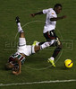 Fluminense's Junior Cesar, left, falls as LDU's Joffre David Guerron takes possession of the ball during the Libertadores Cup final match in the Maracana Stadium of Rio de Janeiro, Brazil, July 2, 2008. Brazil's Fluminense beat Equadors' LDU 3-1 during regular time, but since they lost 4-2 in the first match in Quito, the game went to to extra time, and penalty kicks.  LDU won the shoot-out 3-1.(Australfoto/Douglas Engle)