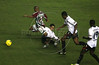 Fluminense's Junior Cesar, left, clears a tackle and the LDU defense during the Libertadores Cup final match in the Maracana Stadium of Rio de Janeiro, Brazil, July 2, 2008. Brazil's Fluminense beat Equadors' LDU 3-1 during regular time, but since they lost 4-2 in the first match in Quito, the game went to to extra time, and penalty kicks.  LDU won the shoot-out 3-1.(Australfoto/Douglas Engle)