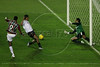 Washington, left, of Fluminense shoots on LDU's goal as goalie Jose Francisco Vevallos dives to save it during the Libertadores Cup final match in the Maracana Stadium of Rio de Janeiro, Brazil, July 2, 2008. Brazil's Fluminense beat Equadors' LDU 3-1 during regular time, but since they lost 4-2 in the first match in Quito, the game went to to extra time, and penalty kicks.  LDU won the shoot-out 3-1.(Australfoto/Douglas Engle)