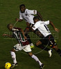 Fluminense's Junior Cesar, left, is surrounded by LDU players during the Libertadores Cup final match in the Maracana Stadium of Rio de Janeiro, Brazil, July 2, 2008. Brazil's Fluminense beat Equadors' LDU 3-1 during regular time, but since they lost 4-2 in the first match in Quito, the game went to to extra time, and penalty kicks.  LDU won the shoot-out 3-1.(Australfoto/Douglas Engle)