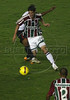 Fluminense's Thiago Neves dribbles past an LDU defender during the Libertadores Cup final match in the Maracana Stadium of Rio de Janeiro, Brazil, July 2, 2008. Brazil's Fluminense beat Equadors' LDU 3-1 during regular time, but since they lost 4-2 in the first match in Quito, the game went to to extra time, and penalty kicks.  LDU won the shoot-out 3-1.(Australfoto/Douglas Engle)