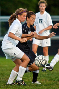 Pickerington North High School's #10 Crisa Thatcher and Westerville Central High School's #13 Meredith Lineberry, left, vie for the ball in the first period of play at Westerville Central High School Thursday evening September 3, 2009. (Photo by James D. DeCamp 614-462-8027)
