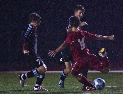 Johnstown High School's #7 Tyler Brooks and #9 Ethan Kincaid try to block a driving Fairbanks High School's #14 Luke Detwiler during the first period of play at Johnstown High School Thursday night September 24, 2009. (Photo by James D. DeCamp 614-462-8027)