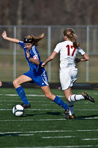 Bexley High Schools #11 Charlotte Myers against Middletown Bishop Fenwick High School's #17 Rachel Hoffman in the OHSAA Girls Division II Regional Final Soccer Tournament held Saturday afternoon November 7, 2009 at the Hilliard Bradley HIgh School. Bexley won 2-0. (Photo by James D. DeCamp 614-462-8027)