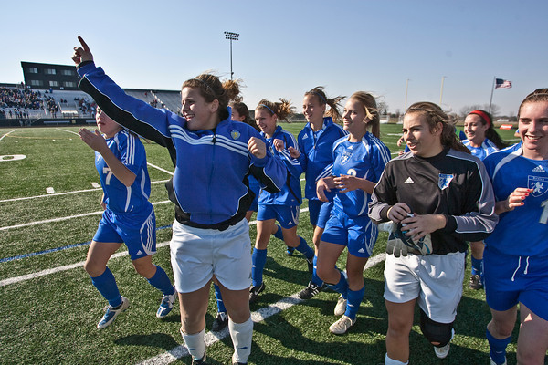 Bexley High Schools Girls Soccer team celebrates their victory over Middletown Bishop Fenwick High School in the OHSAA Girls Division II Regional Final Soccer Tournament held Saturday afternoon November 7, 2009 at the Hilliard Bradley HIgh School. Bexley won 2-0. (Photo by James D. DeCamp 614-462-8027)